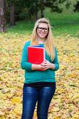 Portrait of happy blonde student girl — Stock Photo