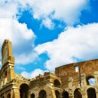 Colosseum in Rome with blue sky — Stock Photo #14838693