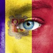 Stock Photo: Humface painted with flag of Andorra