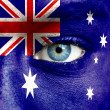 Human face painted with flag of Australia — Stockfoto