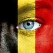 Stock Photo: Humface painted with flag of Belgium