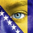 Stock Photo: Humface painted with flag of Bosniand Herzegovina
