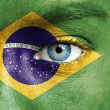 Stock Photo: Humface painted with flag of Brazil