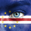 Stock Photo: Humface painted with flag of Cape Verde