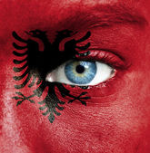 Human face painted with flag of Albania — Stock Photo