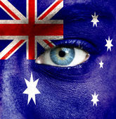 Human face painted with flag of Australia — Stock Photo