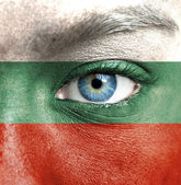 Human face painted with flag of Bulgaria — Stock Photo