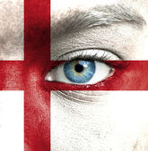 Human face painted with flag of England — Stock Photo