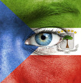 Human face painted with flag of Equatorial Guinea — Stock Photo