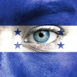 Stock Photo: Humface painted with flag of Honduras