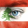 Stock Photo: Humface painted with flag of Lebanon