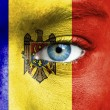 Stock Photo: Humface painted with flag of Moldova