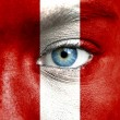 Human face painted with flag of Peru — Stock Photo