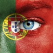Human face painted with flag of Portugal — Stockfoto