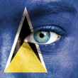 Royalty-Free Stock Photo: Human face painted with flag of Saint Lucia