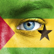 Royalty-Free Stock Photo: Human face painted with flag of Sao Tome and Principe