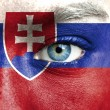 Stock Photo: Humface painted with flag of Slovakia