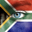 Human face painted with flag of South Africa — Stock Photo #15405223