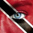 Stock Photo: Humface painted with flag of Trinidad and Tobago