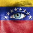 Human face painted with flag of Venezuela — Stock Photo #15406517