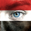 Human face painted with flag of Yemen — Stock Photo #15406645