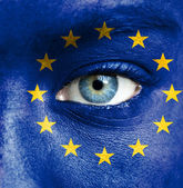 Human face painted with flag of European Union — Stock Photo
