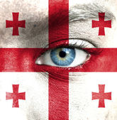 Human face painted with flag of Georgia — Stock Photo