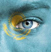 Human face painted with flag of Kazakhstan — Stock Photo