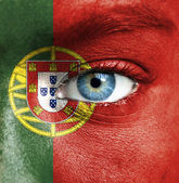 Human face painted with flag of Portugal — Stock Photo