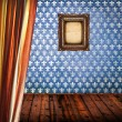 Grunge empty room with blue damask wall and empty frame - Stockfoto