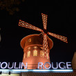 PARIS - OCT 29: The Moulin Rouge by night, on October 27, 2012 i - Stock Photo