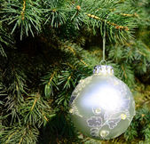 Ornament on Christmas tree closeup — Stockfoto