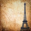Eiffel tower on grunge background — Stock Photo