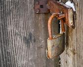 Old padlock on wooden door — Stock Photo