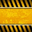Grunge metal plate with warning stripes — Stock Photo #18081967