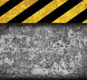 Rustic metal background with warning stripes — Stock Photo