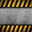 Grunge metal background with black and yellow warning stripes — Stock Photo #18240345
