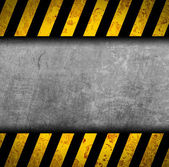Grunge metal background with black and yellow warning stripes — Foto de Stock