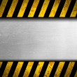 Grunge metal background with black and yellow warning stripes — Stock Photo #18261711