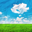 Beautiful green field and blue sky on grunge crumpled paper — Stock Photo
