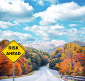 """RISK AHEAD"" sign against road - Business concept — Stock Photo"
