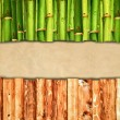 Wood and bamboo background with empty paper — Stock Photo
