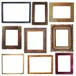 Collection of vintage wooden and golden empty frames isolated on — Stock Photo