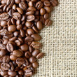 Sack and coffee beans background — Stock Photo