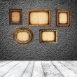 Empty room with blank vintage picture frames — Stock Photo