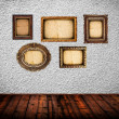Stock Photo: Empty room with blank vintage picture frames