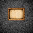 Golden photo frame on grunge wall — Foto de stock #19266269