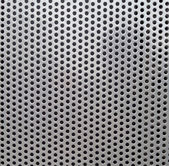 Metal background with holes — Stock Photo