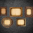 Golden frames on the black wall — Stock Photo