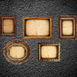 Golden frames on the black wall - Stock Photo